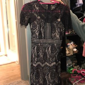 Cute black lace dress with cream under layer